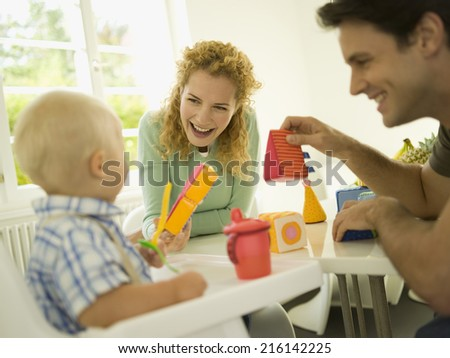 Young family with baby boy - stock photo