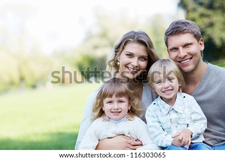 Young family with children - stock photo