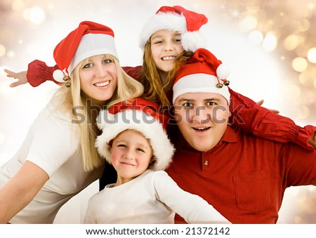 young family with gifts at christmas.Keyword for santa series is santa7