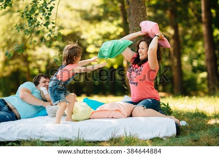 Young Family With Kids Having Fun Colored Pillows Outdoors Parents Two Children Relax