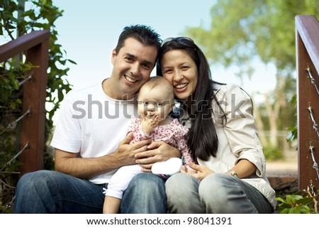 Young Family with Little Baby Girl on Staircase - stock photo