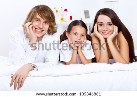 Young family with little daughter at home together - stock photo
