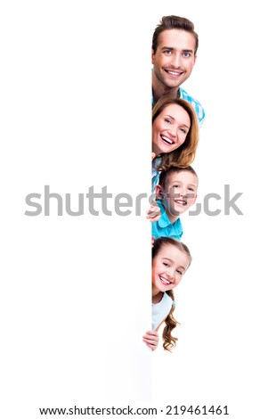 Young family with looking out of the banner - isolated on a white background - stock photo