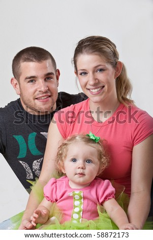 Young family with one year old daughter. - stock photo