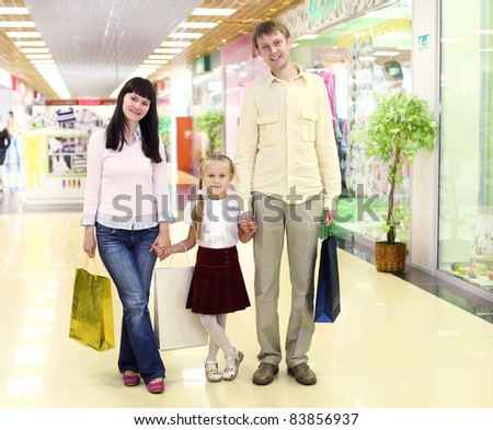 Young family with shopping bags doing shopping
