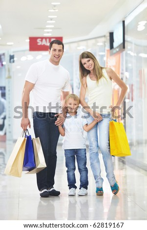 Young family with their bags at the store - stock photo