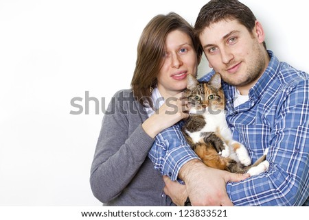 young family with their cat - stock photo