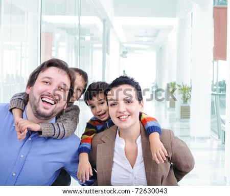 Young family with two children in the shopping mall - stock photo