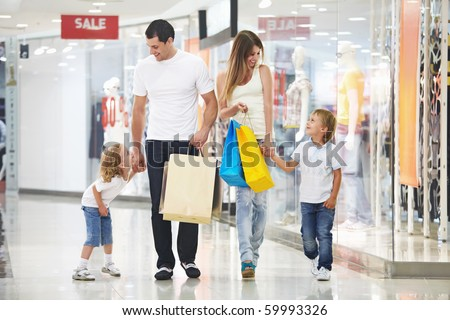 Young family with two children in the store - stock photo