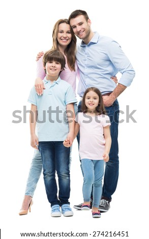 Young family with two children standing together  - stock photo