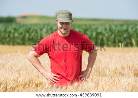 Young farmer in a wheat fields