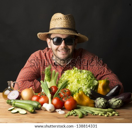 young farmer with vegetables