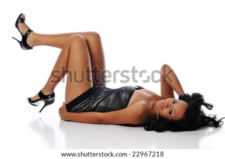 Young fashion african american woman posing and isolated against a white background