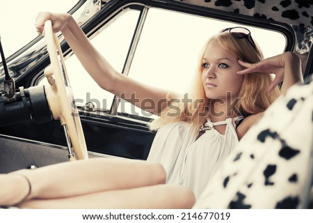 Young fashion blond woman in retro car  - stock photo