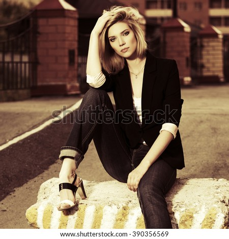 Young fashion business woman on city street - stock photo