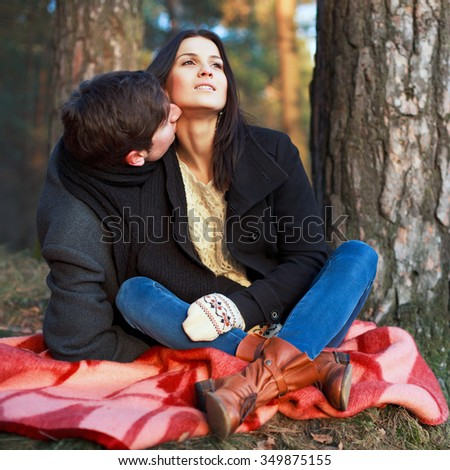 Young fashion couple posing in winter outdoor having fun together  - stock photo