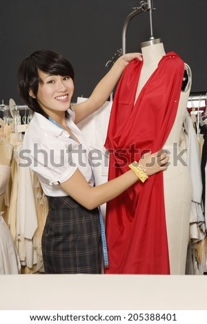 Young fashion designer at work - stock photo