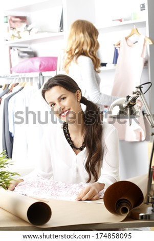 Young fashion designer working in her studio.
