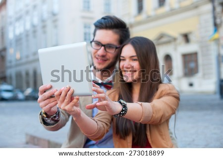 Young fashion elegant stylish couple posing on streets of european city in summer, outdoor - stock photo