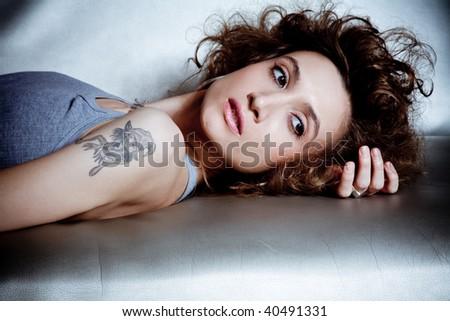 young fashion female model portrait, indoor shot - stock photo
