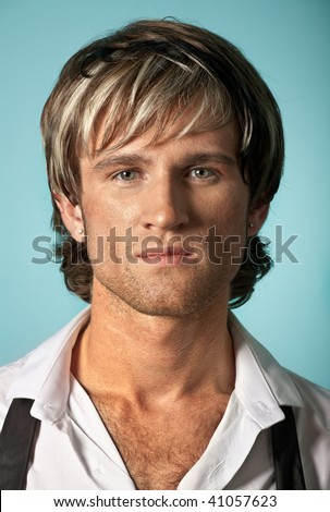 Young fashion handsome male model in a white shirt over blue