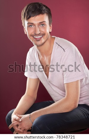 Young fashion handsome man in a white shirt over red - stock photo