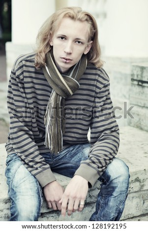 Young fashion male model posing outdoor - stock photo