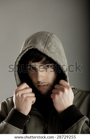 Young fashion man portrait over a grey background - stock photo
