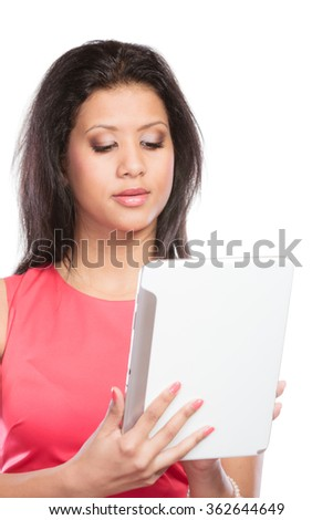 Young fashion mixed race african woman girl using computer tablet online browsing surfing internet. Modern technology.