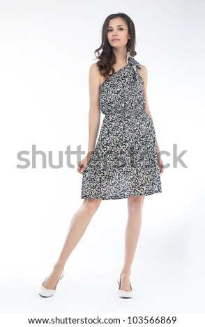 Young fashion model in grey cocktail dress isolated on white background - stock photo