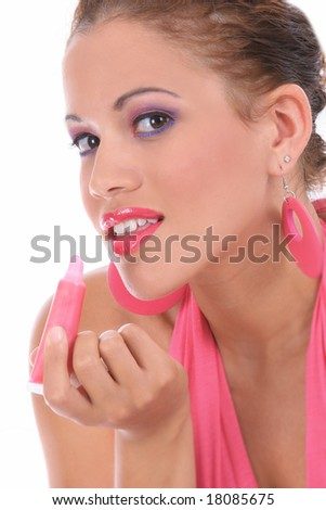 Young Fashion Model in Pink Applying Makeup Isolated