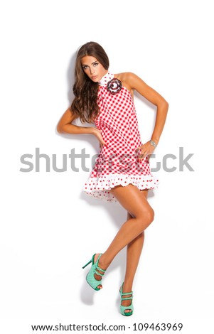 young fashion model in summer dress and high heel shoes studio white - stock photo
