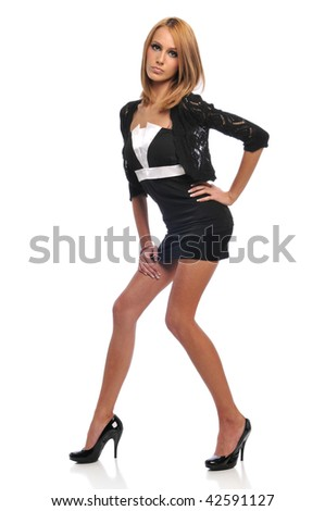 Young Fashion model posing over a white background