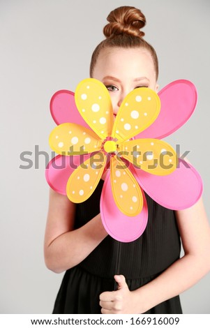 young fashion model posing with fake flower - stock photo