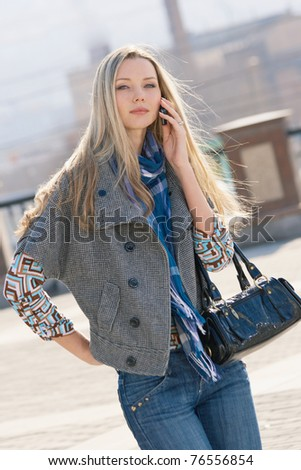 Young fashion model walking at the city - stock photo