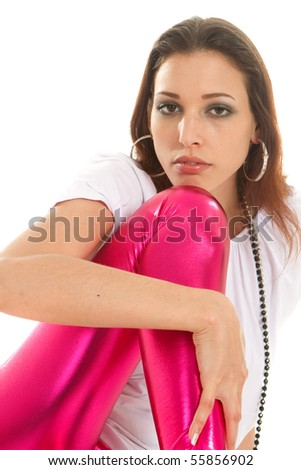 Young fashion model with pink shimery pants over white background. Isolated studio shot.