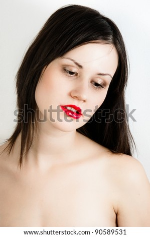 Young fashion model with white skin and red lipstick - stock photo