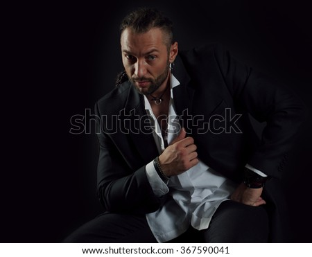 Young fashion sexy man casually dressed in a suit