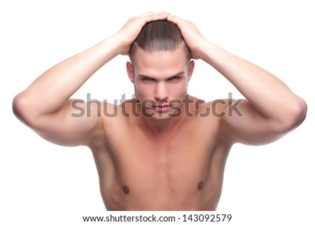 young fashion topless man holding his hair with both hands while looking deeply into the camera. isolated on white background - stock photo