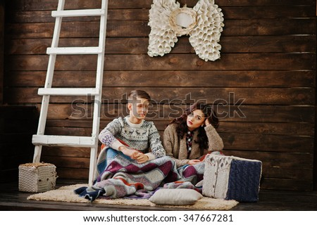 Young fashion winter  couple at wooden background  - stock photo