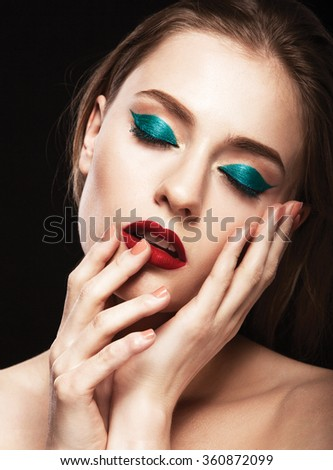 young fashion woman beauty portrait with bright make up in black background