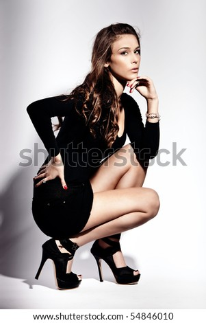 young fashion woman in high heels, studio shot - stock photo