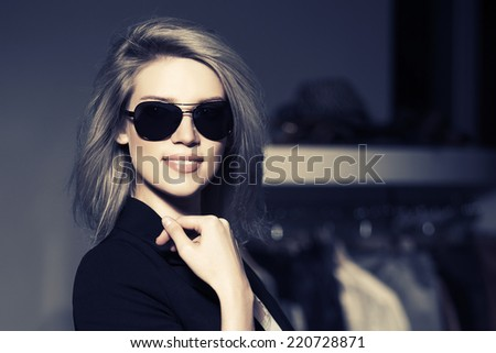 Young fashion woman in the mall interior  - stock photo