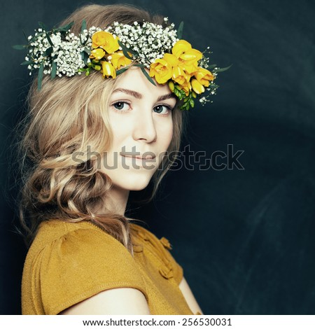 Young fashion woman in yellow with flowers - stock photo