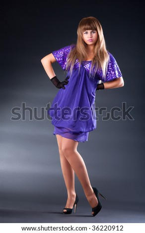 Young fashion woman. On dark background. - stock photo