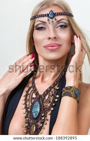 Young fashion woman posing with traditional indian jewellery