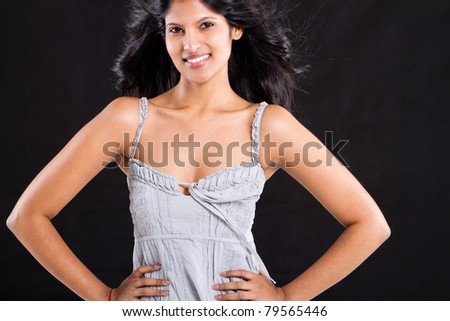 young fashion woman studio portrait on black - stock photo