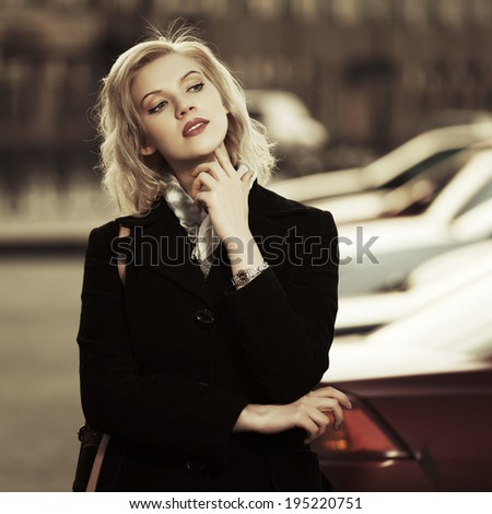 Young fashion woman walking on the city street - stock photo