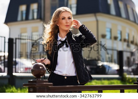 Young fashion woman walking on the city street