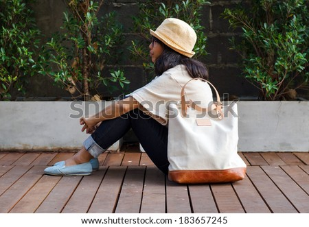 Young fashion woman with a canvas bag, Outdoor portrait